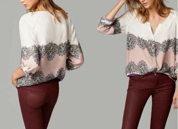 blusa branca floral com detalhes etnicos