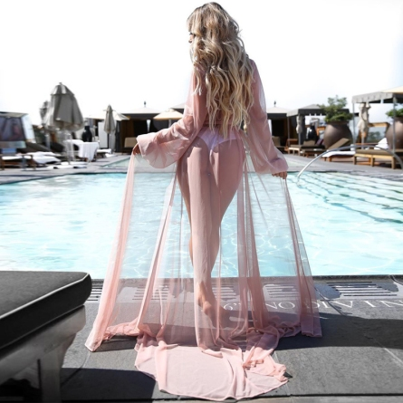 Saída de praia longa transparente rosa